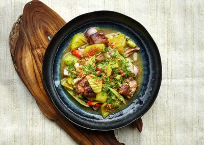 Stir fried pickled cabbage, salt cured mushrooms, fermented onion shoots, smoked pork knuckle and white ginger flower vinegar ( ຂົ້ວສົ້ມຜັກ ຂົ້ວກະລໍ່າປີດອງ,ເຫັດໝັກເກືອ, ຜັກບົ່ວດອງ, ຂາໝູຢ້າງ ແລະ ນໍ້າດອກຂິງດອງ )