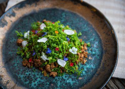 Northern larb salad of pheasant with mouth numbing mak-wean pepper, cloves, hog plum leaves and herb paste  ลาบไก่ฟ้าคั่ว ใส่เครื่องลาบแบบเหนือ  มีความหอมที่โดดเด่นของมะแขว่นและดีปลี