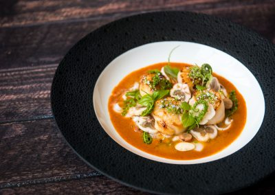 Seared scallops, tossed in a salad of fresh mangosteen, peromia, lemongrass, young coconut, topped with Thai wild almonds.